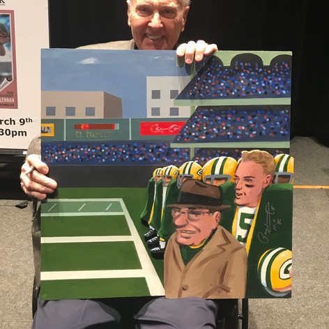 Paul Hornung holding painting
