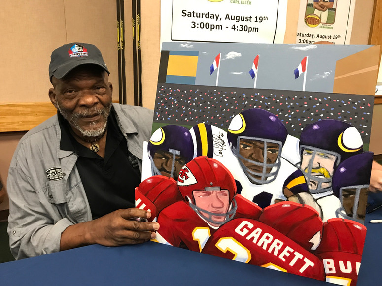 Carl Eller with painting