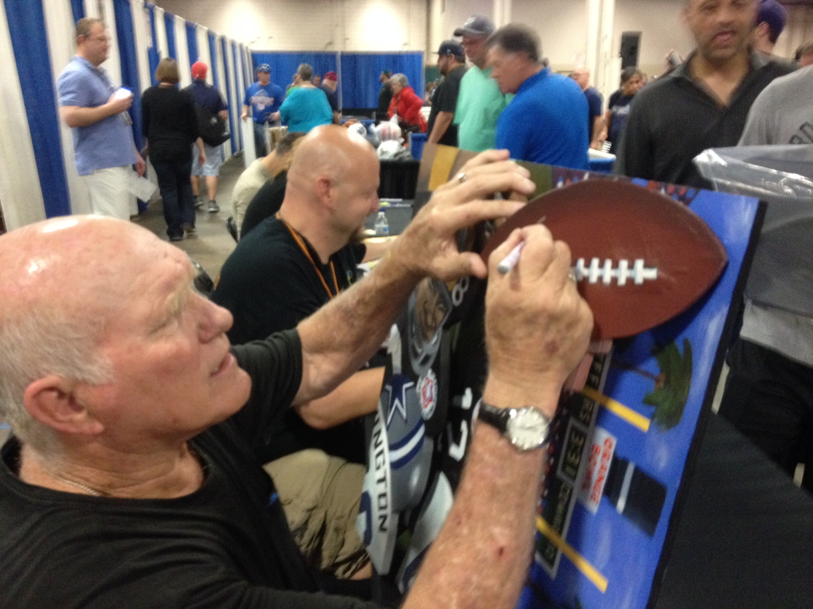 Sax Terry Bradshaw signing football