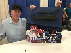 Sax Jim Kelly signing painting