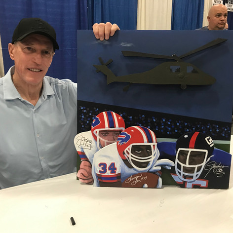 Sax Jim Kelly signing painting
