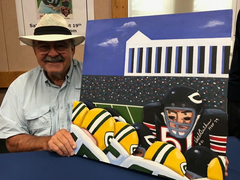 Dick Butkus with painting