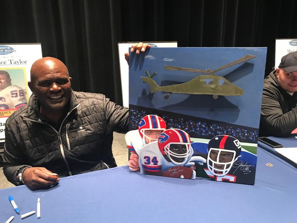 Lawrence Taylor with painting