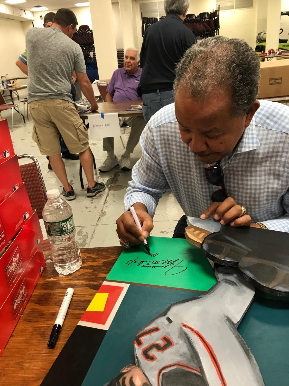 Juan signing painting
