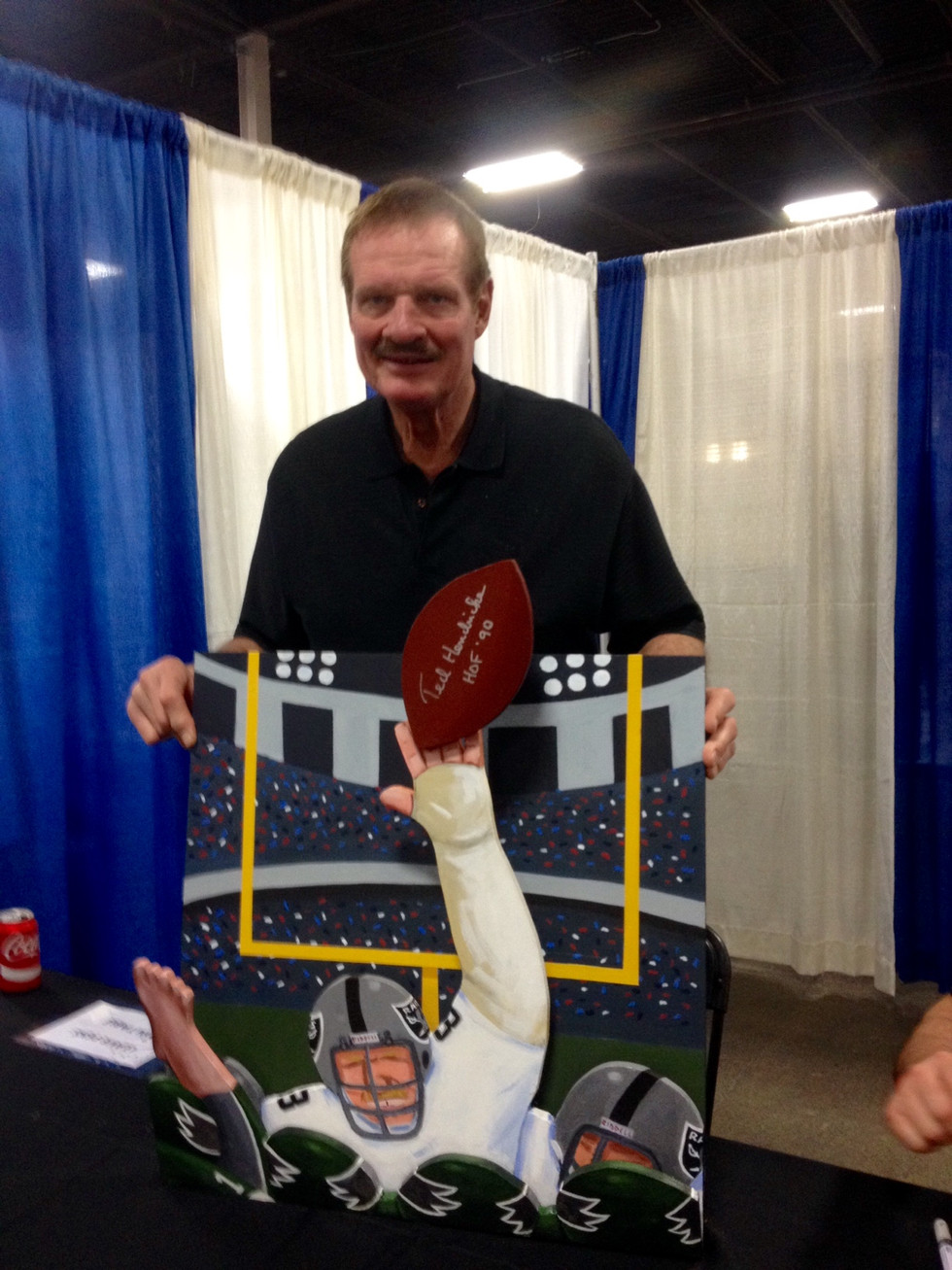 Ted Hendricks with painting
