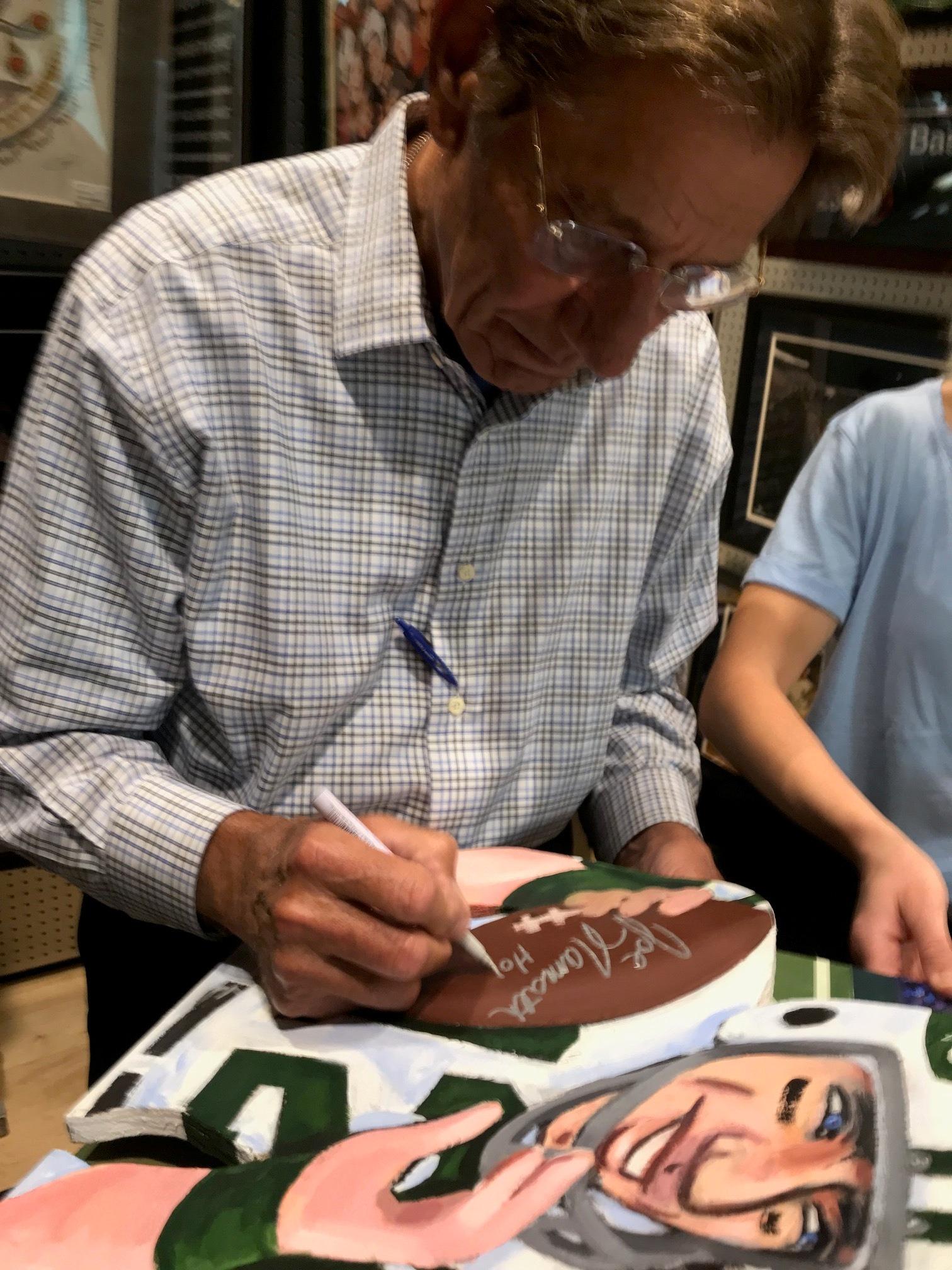 Namath signing painting