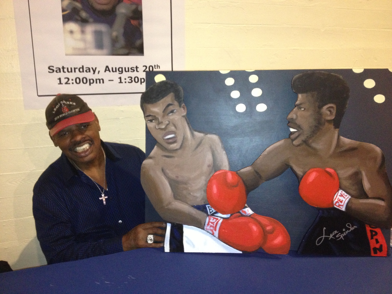 Leon Spinks with painting
