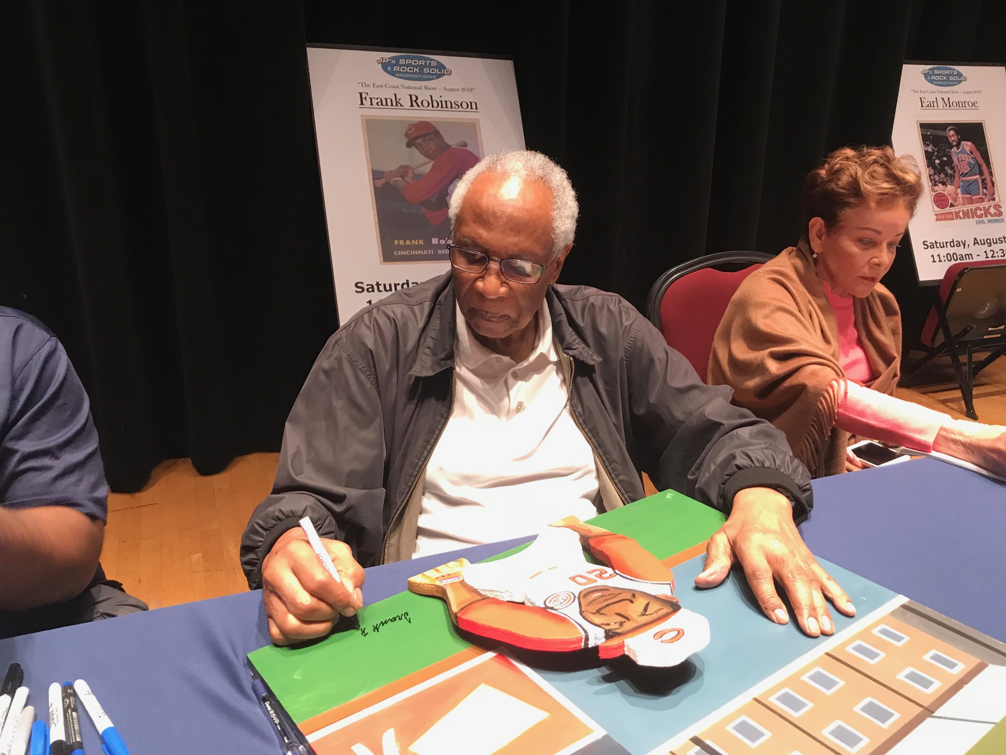 Frank Robinson signing painting