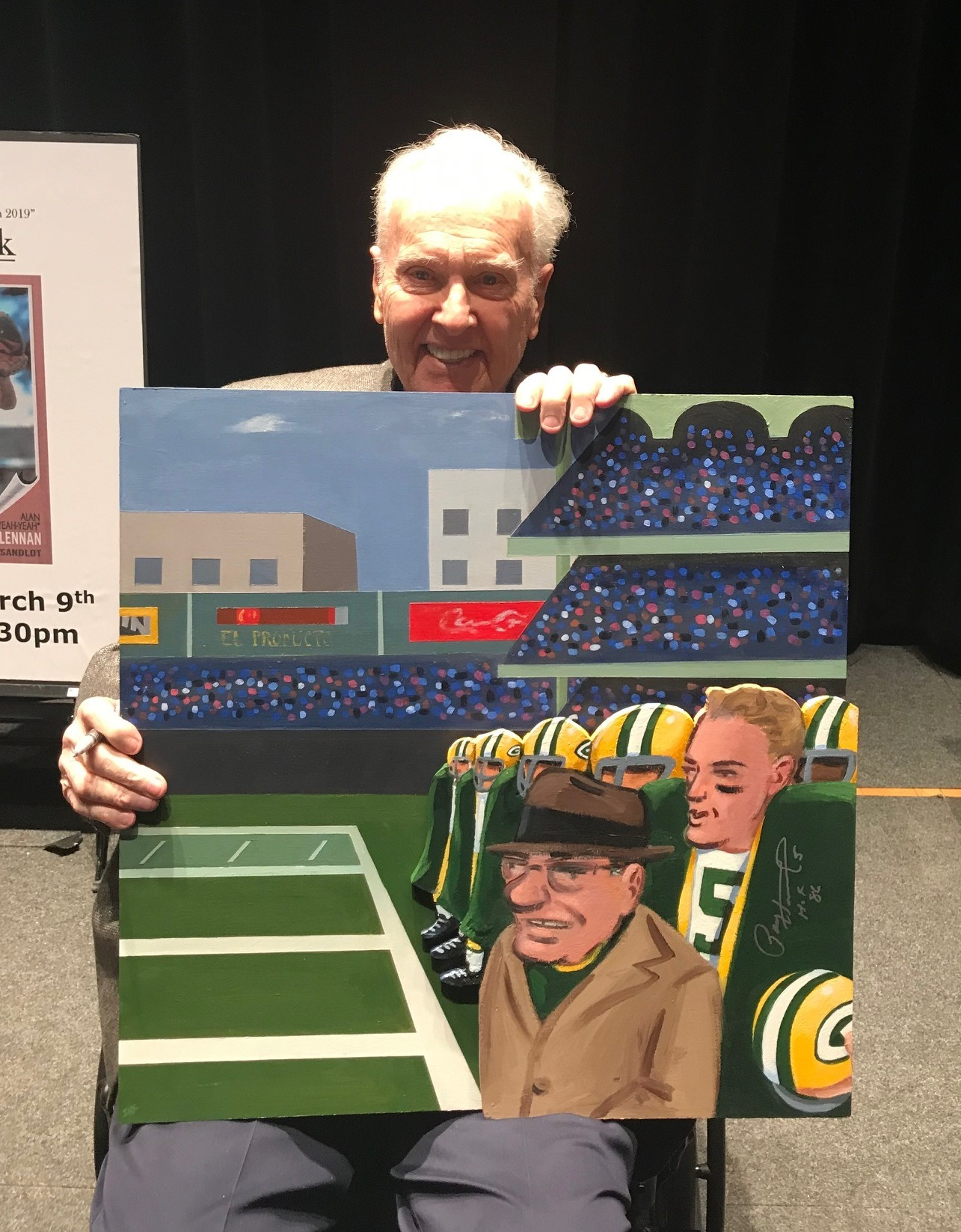 Paul Hornung holding painting_edited