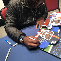 Sax Lawrence Taylor signing painting