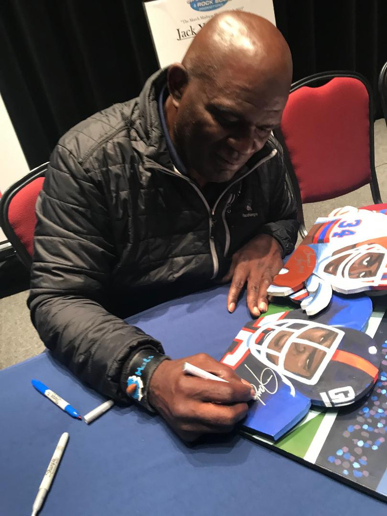 Lawrence Taylor signing painting