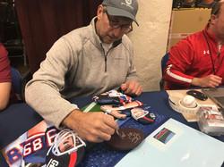 Mark Bavaro signing painting