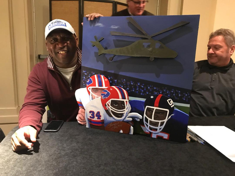 Thurman Thomas with painting