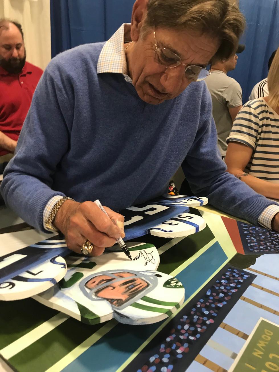 Joe Namath signing painting