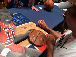 Clyde signing painting