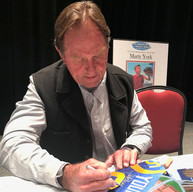 Jack Youngblood signing painting