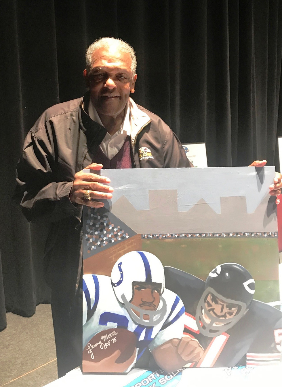 Lenny Moore with painting