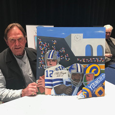 Jack Youngblood holding painting