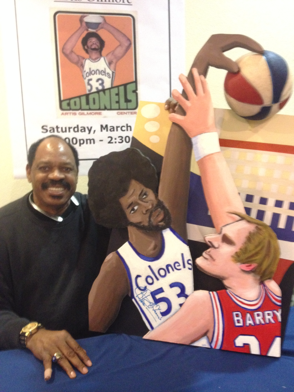 Artis Gilmore with painting