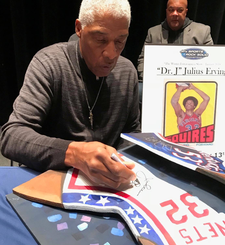Dr. J signing