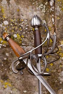Swords, rapier, dagger leaning against a