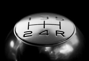 close-up-of-gear-shift-over-black-backgr