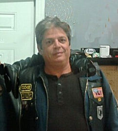 Short heavyset white male brown hair wearing biker leather jacket with patches: deceased