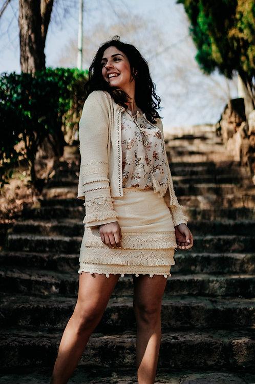 Falda en tejido tweed con pasamanería