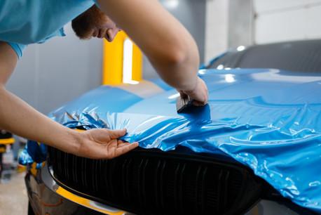car-wrapper-puts-protective-foil-film-ho