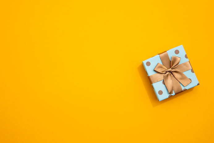minimalistic-wrapped-gift-on-yellow-back