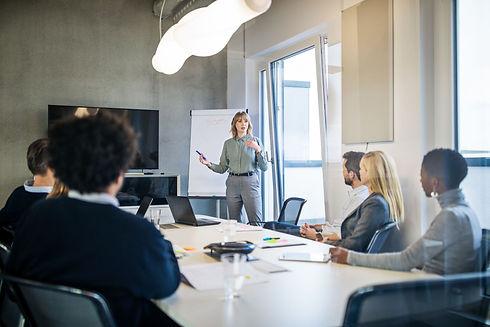 businesswoman-addressing-a-meeting-aroun