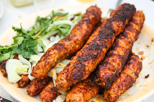 Grilled meat kebab with onion. Closeup.