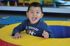 Child paying in preschool gym