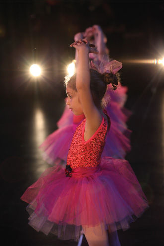 Profile of child performing ballet