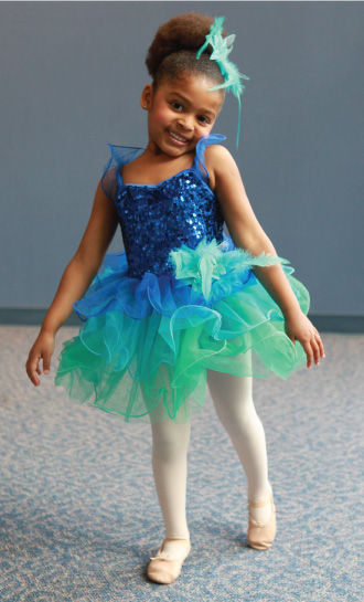Child posing in dance leotard