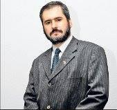 His Excellency Agent Dr. Sebastian Sarbu