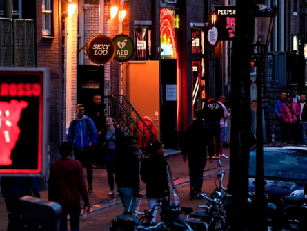 'No kissing': Amsterdam's red light district reopens after coronavirus shutdown