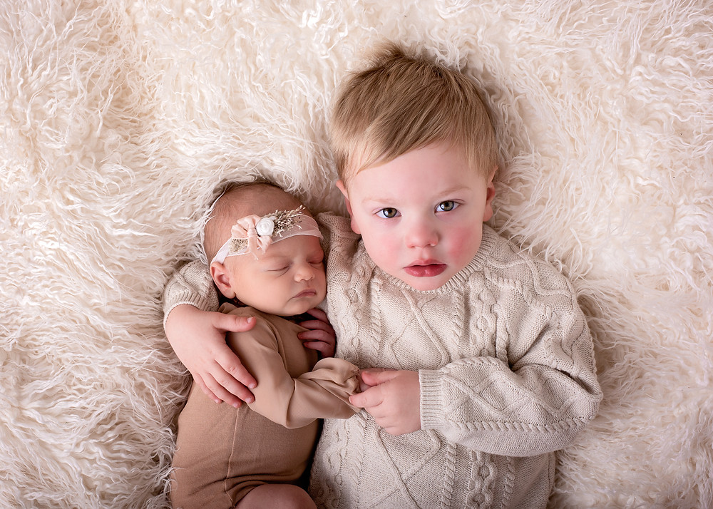 Siblings at a Maine newborn photography studio