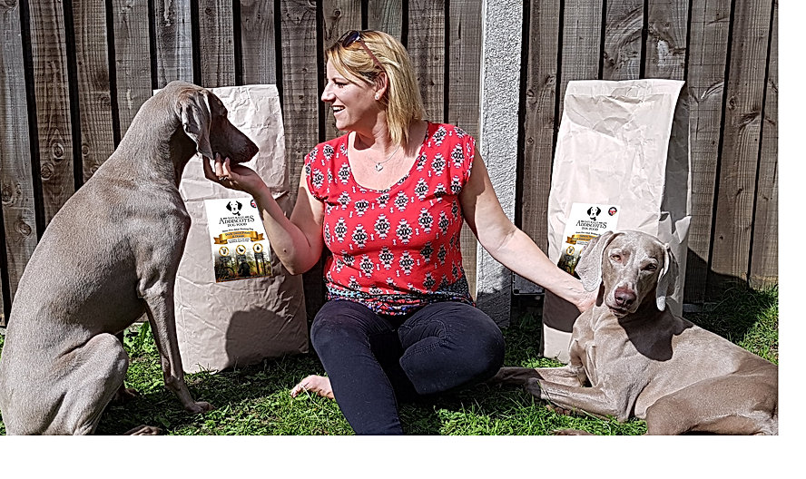 Founder Claire in the garden with her weimaraners and a sack of 15kg working dog Duck and Orange flavour