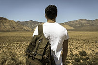 Man with backpack in desert