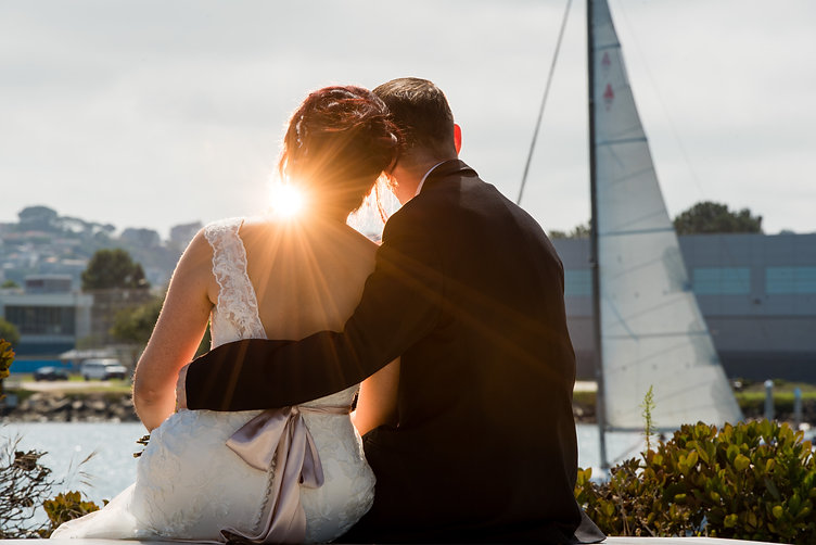 Bride and groom admiring sunset