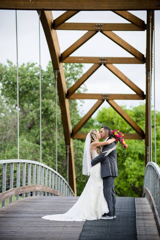 kissing couple on bridge
