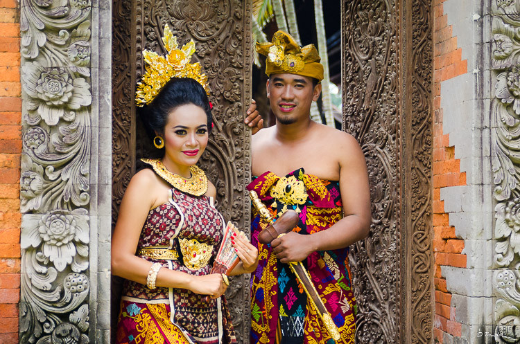 Balinese couple in traditional garb for engagement photos.