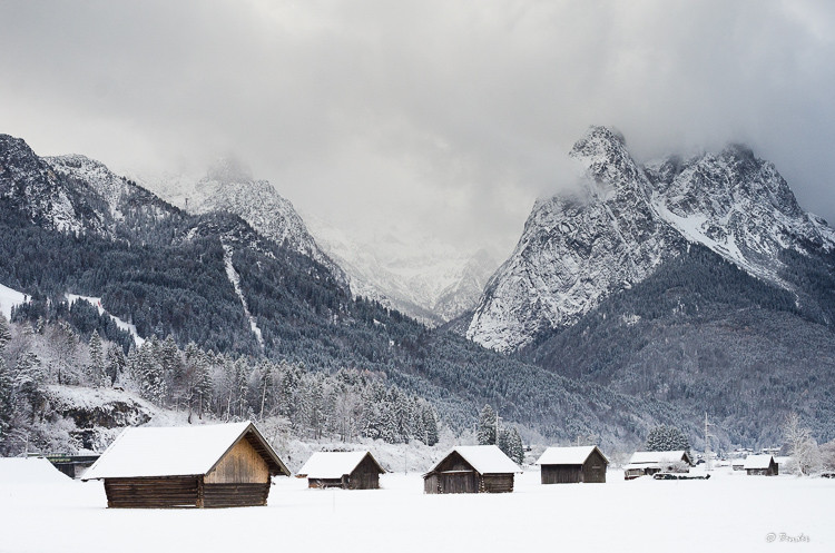Bavarian log cabins in a mountain valley