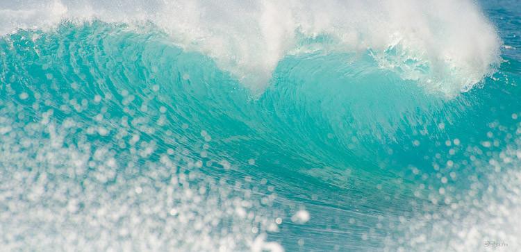 """Sea Glass in Motion"" A bright aqua-blue wave crests."