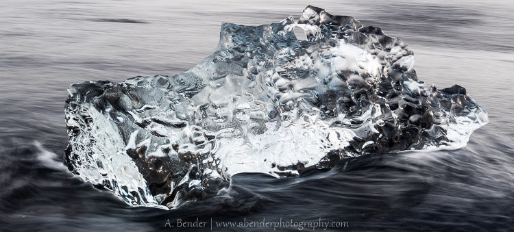Iceberg on black sand
