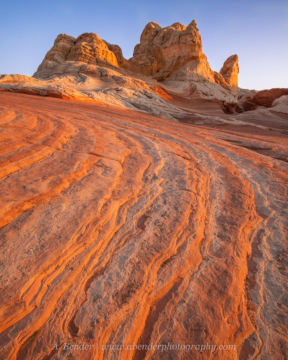 Sunset light reflects off sandstone striations at White Pocket in northern Arizona   A Bender Photography LLC
