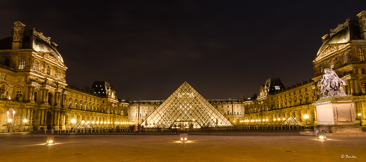 The Louvre square at night