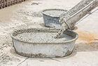 stock-photo-pouring-of-wet-concrete-form