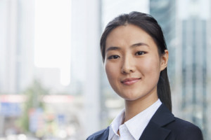Smiling Young Businesswoman Looking at Camera